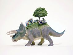 Toy Mammals and Dinosaurs Burdened with Miniature Civilizations by Maico Akiba toys sculpture miniature dioramas #burden #sculpture #triceratops #back #civilisation #dinosaur #minature