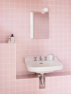 Feilders installed seven new bathrooms in the house and annex, no two exactly alike. This one has one of the house's original sinks set in a tiled niche. (Pink tiles sourced from Palatino.)