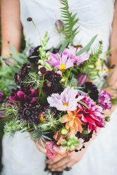 http://www.100layercake.com/blog/wp-content/uploads/2014/10/Frida-Kahlo-day-of-the-dead-wedding-inspiration-11.jpg #flowers
