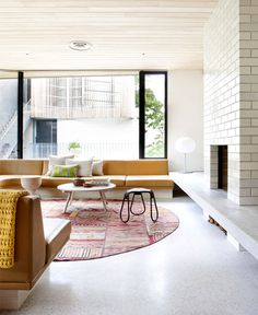 Brick House with Smooth Curves u shaped built in seating #interior #design #decor