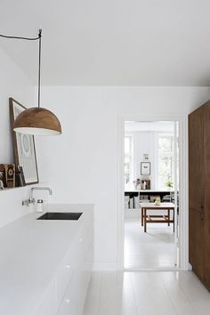 White kitchen with wood accents. #kitchen