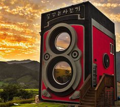 Camera Enthusiast Builds a Coffee Shop Shaped Like an Enormous Rolleiflex Camera #shop #camera #building #architecture #coffee #rolleiflex