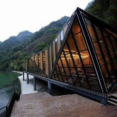Tianmen Mountain Restaurant by Liu Chongxiao #glass #river #mountain #architecture