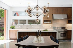 Kitchen, Pendant Lighting, Wood Cabinet, Range Hood, Subway Tile Backsplashe, Range, Ceiling Lighting, and Wall Oven Photo 1 of 2509 in Best Kitchen Photos from Casual Hip Marin County