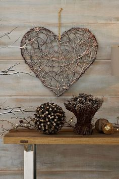 A wood inspired heart shaped craft using twigs to shape the symbol. Wires and ropes are used to hold the shape as well as the intricate and
