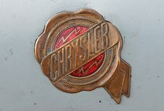 Chromeography #badge #red #automobile #seal #bolt #lightning #vintage #gold