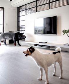 Dark and Moody Apartment Interior big sculpture pig #interior #decor #living #pig #home #colors #dark #room