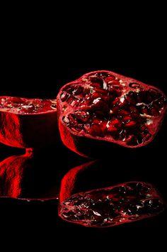 Juicy Pomegranate by Niermala B. Timmers http://www.niermalatimmers.com #drama #timmers #red #pomegranate #juicy #photo #fruit #bouwina #contrast #black #mirror #shiney #photography #healthy #niermala #hard #lighting #still #life #shadow