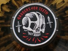 Dribbble - skullsquad patch by Craig Robson #teeth #red #black #daggers #skull