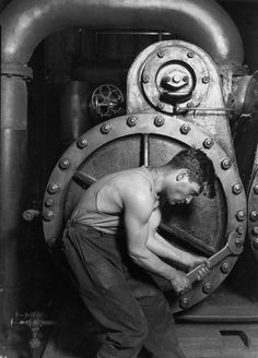 Power house mechanic working on steam pump, Lewis Hine (1920) #vintage #photography #mechanic #steam #worker #muscles #pump