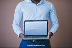Elegant businessman presenting laptop Free Psd. See more inspiration related to Mockup, Business, Technology, Computer, Man, Laptop, Presentation, Notebook, Elegant, Present, Businessman, Mock up, Success, Business man, Modern, Open, Show, Display, Screen, Up, Successful, Computer screen, Holding, Mock, Presenting and Showing on Freepik.