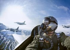 Cockpit view of fighter pilot with F-16s.