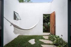 Small courtyard with hammock. Casa da Mangueira by Alan Chu. #patio #courtyard #hammock #patio #courtyard #hammock