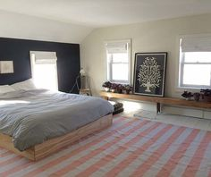 "We painted the walls BM French Canvas, the trim BM White Dove and the floor a standard porch paint white. We painted our ""headboard"" wall BM #stripes #bed"