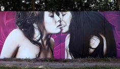 Womans kiss on graffiti street art