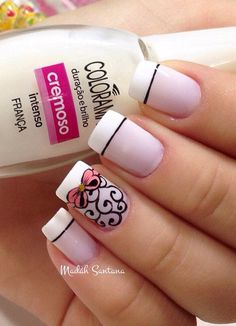 Pretty white and sheer pink French tip with details painted in black polish. Add more drama to your French tips with matching pink ribbons a