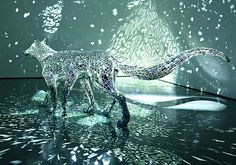 A Reflective Six Legged Wolf Covered in Mirror Shards by Tomoko Konoike