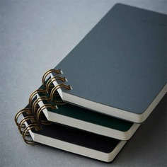 Jot down notes and make lists with the Corner Ring Notepad! It features diagonal brass rings for easy page-turning and comfortable writing. The leather-like cover finished by hand keeps the pages resistant to wear and tear. It also comes with a corner elastic band that keeps everything in place. Crafted in Japan.