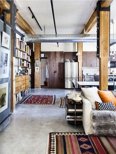 industrial apartment #interior #sofa #concrete #home #wood #kitchen #industrial #rug