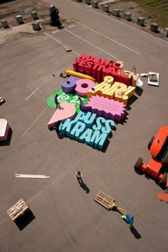 Cool 3D poster is made with letters so big that they can crush a human #big type #wood #installation