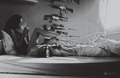 ... under Clutchy Hopkins tracks. on Photography Served #gun #photography #bed #girl