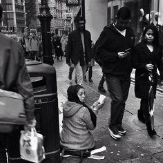 Roma woman begs near @harrods as weekend shoppers walk idly by #Knightsbridge #London #BOSS #PRET