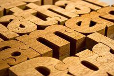 Wooden typographic puzzles #wood #puzzle #typography