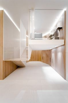 A Beirut Penthouse with a Floating Staircase & Wooden Skin