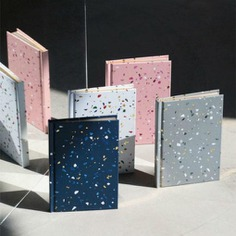 Terazzo Notebook The Terrazzo Notebook is a beautiful and festive blank-paged notebook, great for jotting down your ideas and notes! It is bound in hardcover and features beautiful flecks of color and gold leaf. It also features environmentally friendly, tree-free paper.