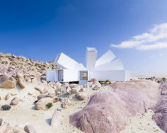 A Film Producer's Desert Retreat Is a Starburst of Shipping Containers #architecture