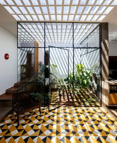 An Open Plan Brazilian House Shows Beautiful Tiles Cladding - InteriorZine #architecture #house #home #decor #interior