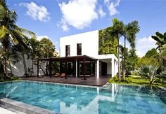 Green Villa with Clean Lines and Open Spaces rich plant life pool area #house #pool #wall #architecture #green