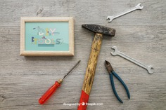 Tools and frame Free Psd. See more inspiration related to Frame, Mockup, Photo frame, Photo, Mock up, Tools, Hammer, Wrench, Up, Male, Screwdriver, Objects, Things, Composition, Mock, Pliers and Masculine on Freepik.