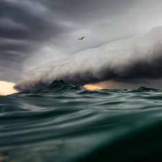 Photographer Swims Out to Sea to Capture Spectacular Storm Shot - My Modern Metropolis #ocean #clouds #water #weather #photography #storm #sea #awesome