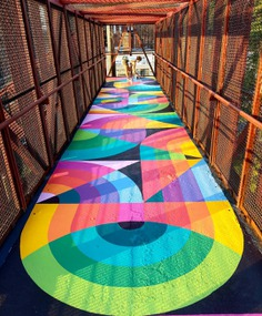 Artist Duo Brings Life Into A Boring Old Stairway By Painting A Bright And Colorful Rug-Shaped Mural