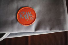 RIFFLE NW on Behance #riffle #badge #design #orange #nw #uniform
