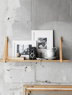 Wooden+leather homemade shelf on concrete wall