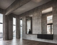 "Concrete interiors at ""The Silo"" by COBE in Copenhagen A former silo in Copenhagen transformed into a stunning residential complex 
