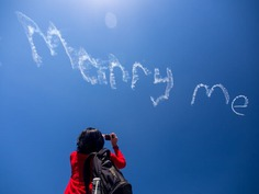 Propose by skywriting