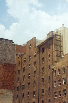 Manhatten Miss AW13 Magazine Topshop USA #brick #sky #yellow #building #architecture #brown #gray #manhatten #blue