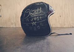 Death Is Just A Phase hand lettered motorcycle helmet.