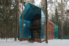 These two-story guesthouses by Totan Kuzembaev Architecture Studio can be found in the forests outside of Moscow. #architecture