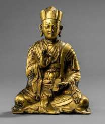 Fire gilt Bronze of a seated priest