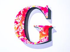 G #red #pink #yellow #orange #letter #paint #type #splatter #shadow