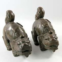 A Couple of front-of-house dogs made of Bronze. CHINA, 1. Half of the 20. Century