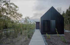 format elf nestles dark barn-shaped houses into bavarian forest #home