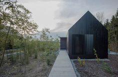 format elf nestles dark barn-shaped houses into bavarian forest #home