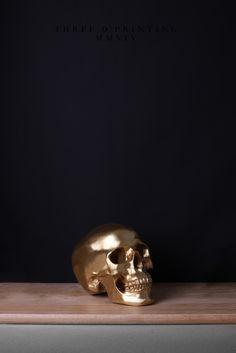 3D Printing, from Time Capsule (2014) Artist: Isabel Sierra y Gómez de León http://isabelsierraygomezdeleon.com/post/91656261513/timecapsu #composition #black #centered #wood #photography #art #gold #life #skull #still #shelf #technology