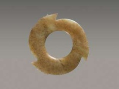 A FASCINATING YABI, OR NOTCHED DISC, WITH THREE POINTED PROTRUSIONS ENRICHED WITH THIN AND DELICATELY CARVED NOTCHES