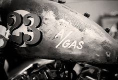 agas1copy.jpg (image) #sign #painted #gas #numbers #type #hand #motorcycle #typography